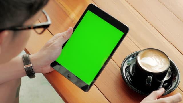 Over shoulder shot of Using digital tablet,Green screen video