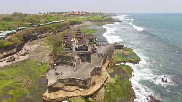 Over Tanah Lot temple Bali aerial 4k video