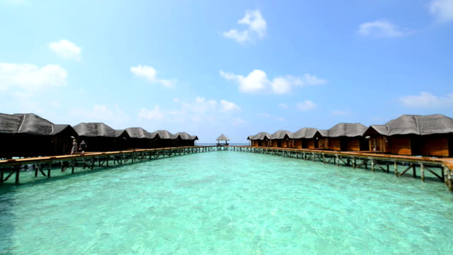 Over water bungalows with steps into amazing green lagoon video