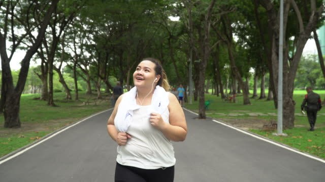 Over weight woman running outdoor Thailand,Running,One Woman Only, Women, large build, Dieting  Save large build stock videos & royalty-free footage