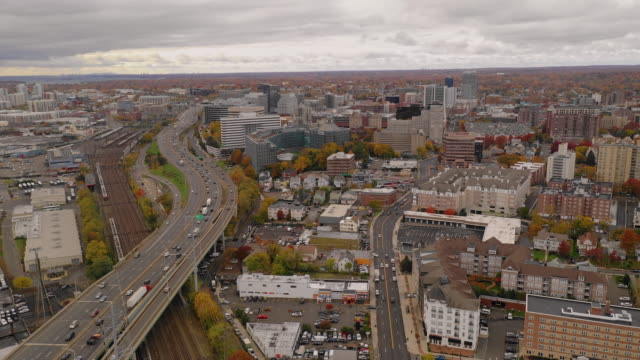 Overcast Skies Aerial View Highway Traffic Stamford Connecticut Commuters travel through the cdowntown city center of coastal Connecticut at Stamford connecticut stock videos & royalty-free footage