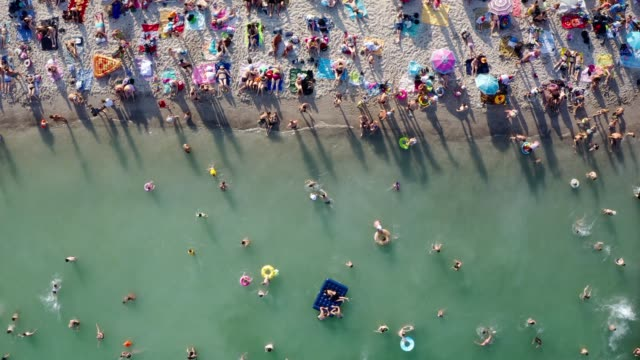 overcrowded beach vacation top view. Having fun on beach summer vibes - video