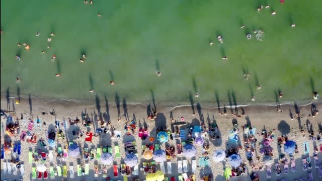Overcrowded Odessa Ukraine beach summer high tourist season. - video