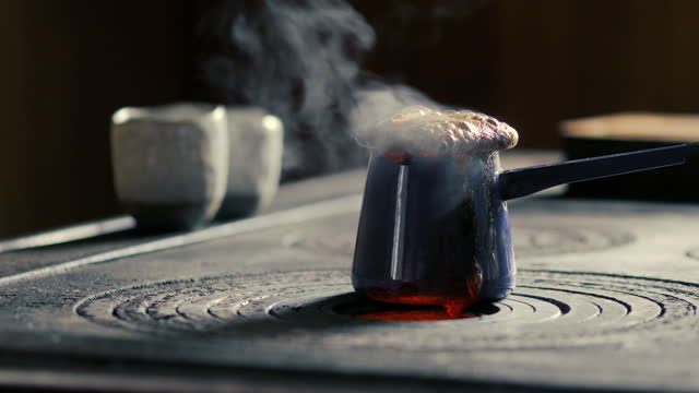 Overflowing Coffee on Wood Burning Stove