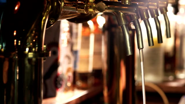 Overflowing glass of beer. video