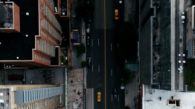 overhead aerial cars driving in Midtown Manhattan traffic New York City