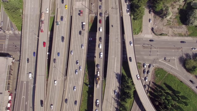 Overhead Aerial of Commuters on City Streets and Travelers on Freeway video