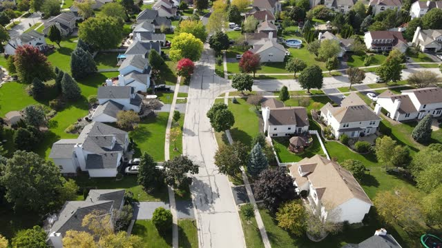 Overhead aerial view of colorful autumn trees, residential houses and yards along suburban street in Chicago area. Midwest USA Overhead aerial view of colorful autumn trees, residential houses and yards along suburban street in Chicago area. Midwest USA district stock videos & royalty-free footage