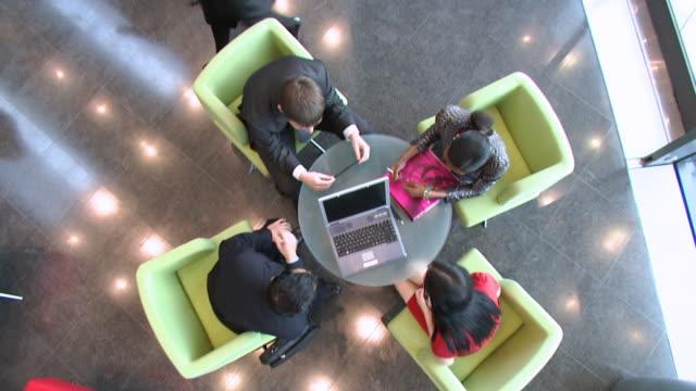 Overhead business coffee meeting video