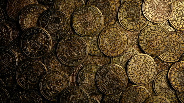 overhead shot of antique coins rotating - scatola del tesoro video stock e b–roll