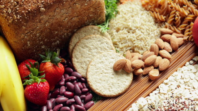 overhead shot of foods containing healthy or good carbohydrates - węglowodan jedzenie filmów i materiałów b-roll
