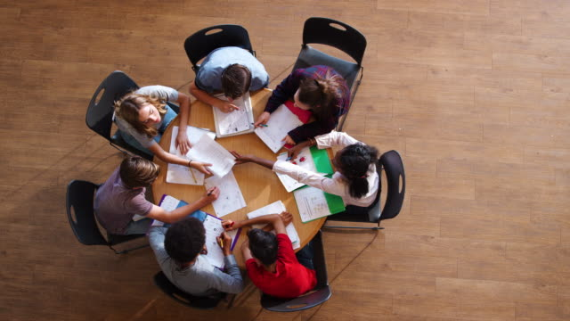 Overhead Shot Of High School Pupils In Group Study Around Table video