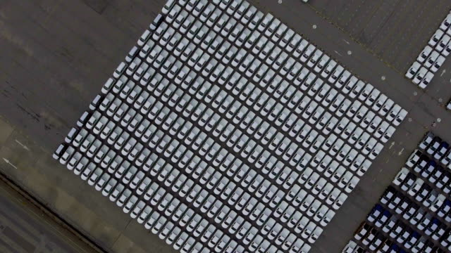 Overhead shot of new cars in the parking lot, Aerial view video