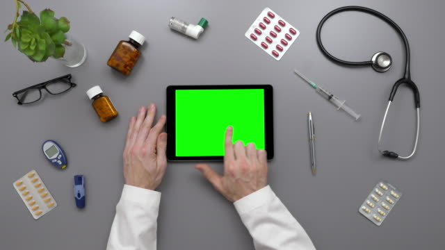 Overhead Top View Of Male Doctor Using Digital Tablet At Desk video