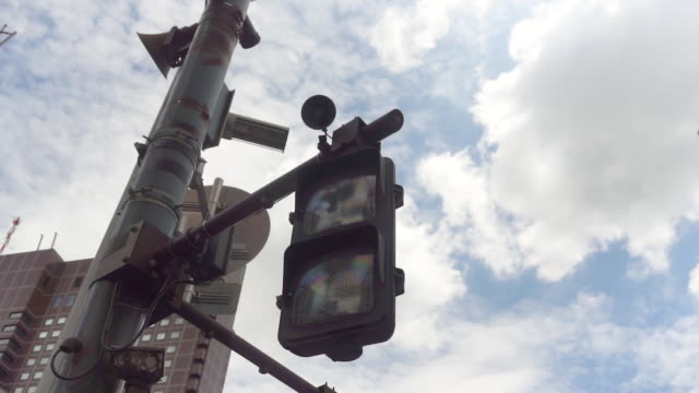 HD Overhead traffic light changing with blue city in city