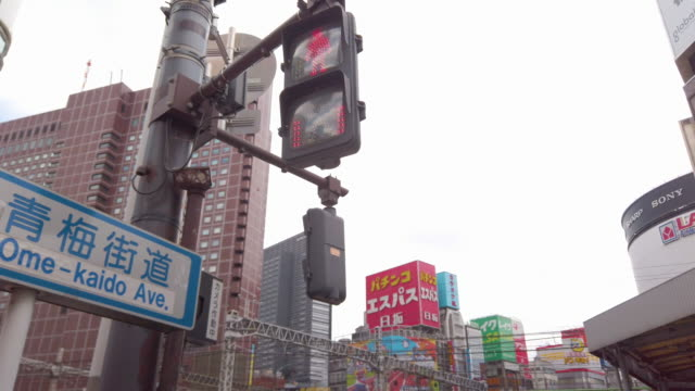 4K Overhead traffic light changing with blue city in Tokyo city