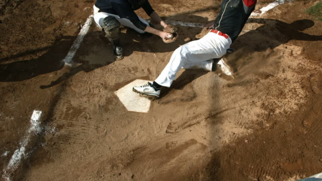 Overhead view of baseball player sliding into home plate video
