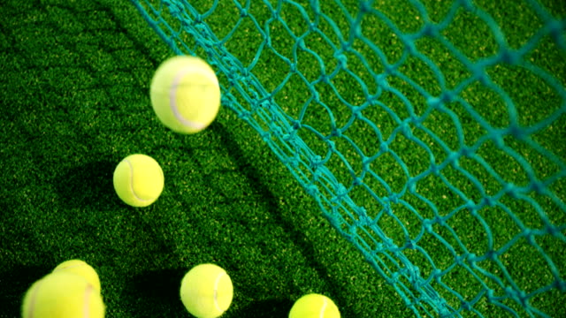 Overhead view of tennis balls on grass 4k video