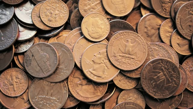 Overhead view of U.S. coins 4k video of Overhead view of U.S. coins us coin stock videos & royalty-free footage