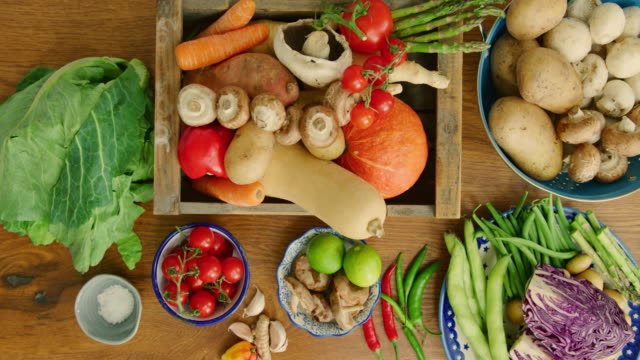 Overhead View Of Various Fresh Vegetables In Containers On Kitchen Counter Overhead view of various fresh vegetables on kitchen counter. Healthy food is arranged in kitchen. It is at home. 4K Resolution. cabbage stock videos & royalty-free footage