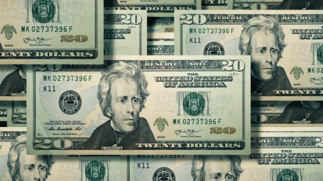 overhead view of wall of cascading $20 dollar bills, u.s. currency - avidità video stock e b–roll