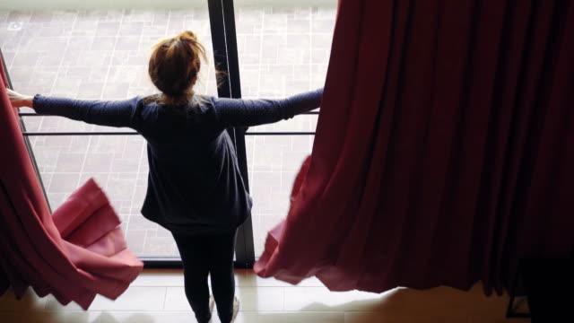Overhead view of woman walking through modern home video