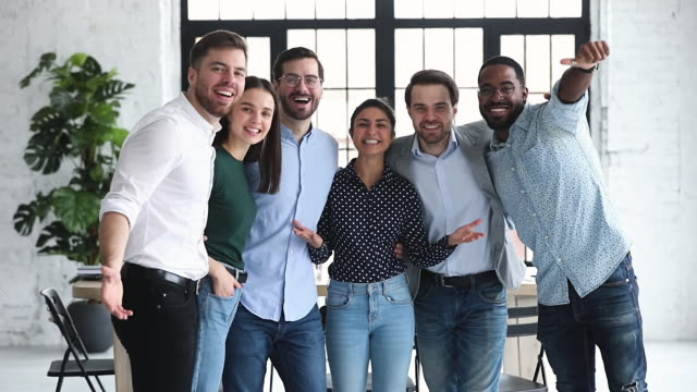 Overjoyed diverse business team celebrate professional triumph together
