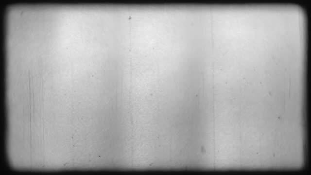 overlay effekt på ram imitation av gamla film med fibrer och spannmål på grå bakgrund - sentimentalitet bildbanksvideor och videomaterial från bakom kulisserna