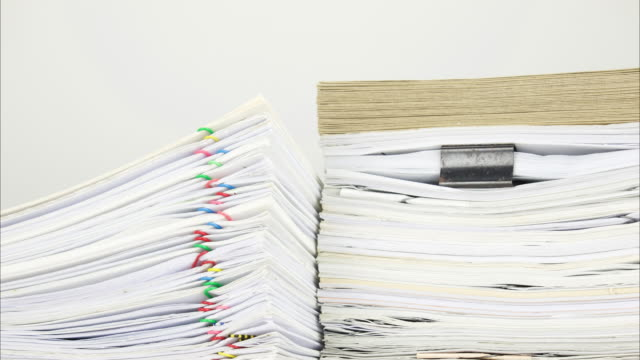 Overload document and envelope on paperwork with white background time lapse video