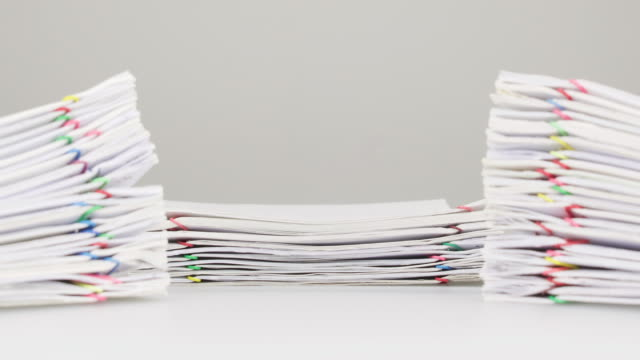 Overload paperwork have dual blur pile document foreground time lapse video