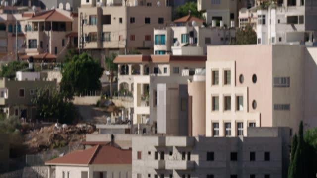 上に昇る大モスクとイスラエルのアラブ都市の概要 - 人の居住地点の映像素材/bロール