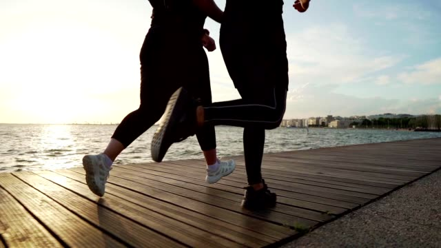 overweight woman jogging with trainer - body positive video stock e b–roll