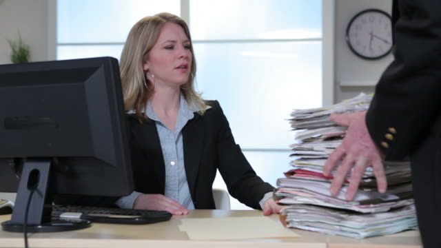 Overworked business woman in office  heap stock videos & royalty-free footage