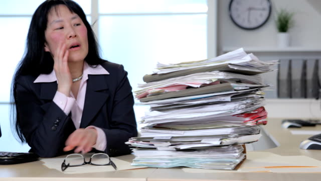 Overworked business woman in office video