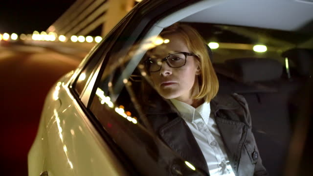 MS Overworked businesswoman driving home at night video