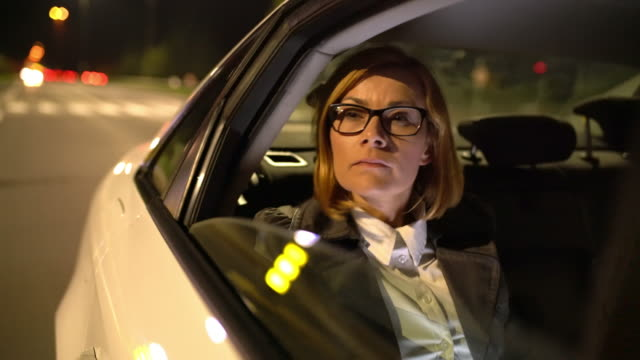 MS Overworked businesswoman on the back seat of a taxi video