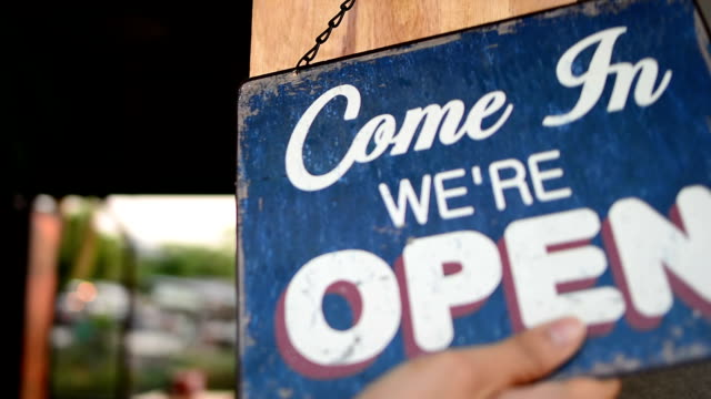 owner opening shop - - open sign stock videos & royalty-free footage
