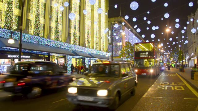 Oxford Street at night before Christmas with Traffic and people walking video