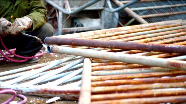 Oxygen welding cutting metal, construction site. video