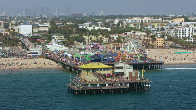 AERIAL Pacific Park on the Santa Monica Pier in Santa Monica, CA Aerial shot of an oceanfront amusement park, the Pacific Park, on the Santa Monica Pier in Santa Monica, California. Shot in USA. western usa stock videos & royalty-free footage
