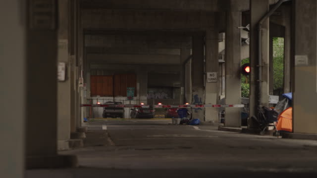 PORTLAND, OR - May 2020: A Pacific Union train crossing under a freeway overpass PORTLAND, OR - May 2020: A Pacific Union train crossing under a freeway overpass homelessness stock videos & royalty-free footage