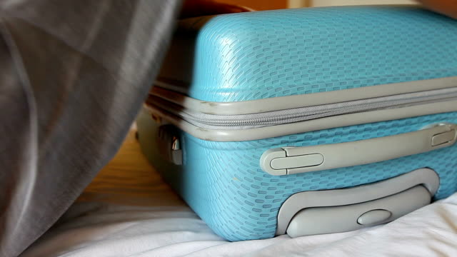 pack suitcase HD1080P:pack suitcase stuffed stock videos & royalty-free footage