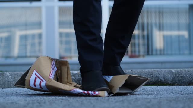 vídeos de stock e filmes b-roll de package destroying - cardboard box