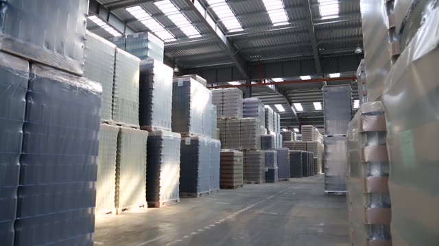 Packing of bottles in workshop of glass factory - video
