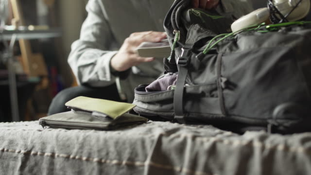 packing rucksack - leaves стоковые видео и кадры b-roll