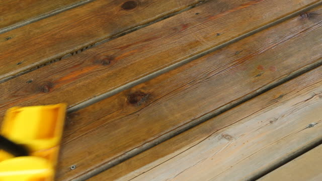 Pad Brush Applying Stain to Wood Deck Boards video