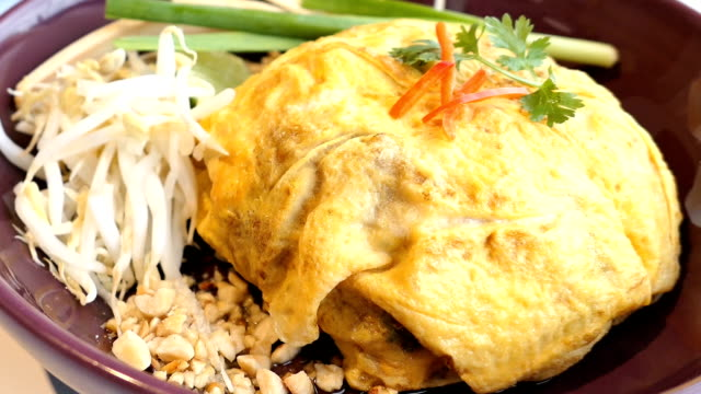 Pad thai wrap with egg Pad thai wrap with egg padding stock videos & royalty-free footage