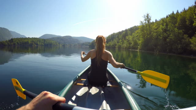 Paddling canoe on a pristine lake video