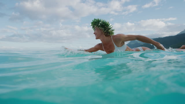 Paddling out for a surf in paradise video
