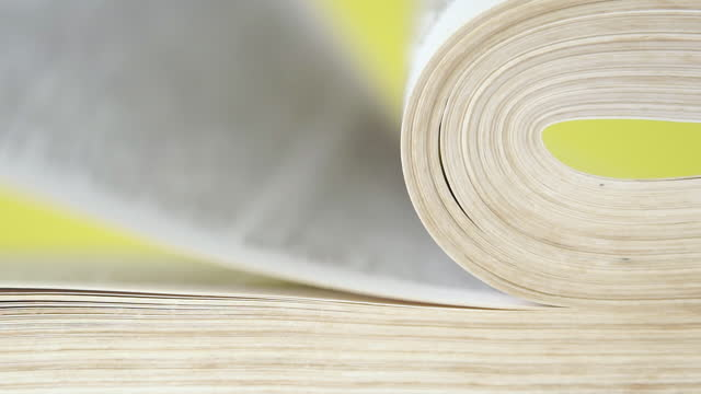 vídeos de stock e filmes b-roll de pages of a book falling and turning over in slow motion. on a bright colored yellow background - filosofia